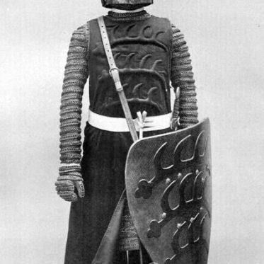 Ritter aus der Mitte des 13. Jh. in Halsberge, Brünne, Waffenrock, Schwert.