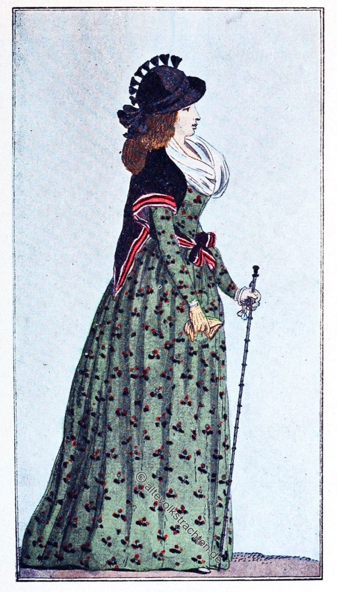 Englisches Etuikleid aus Baumwolle, mit Blumen 1794. Schwarzer Seidenschal, gestreifter Rand, um die Taille gebunden.